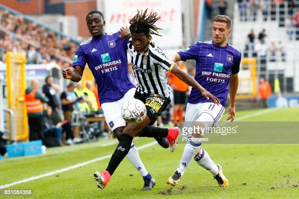 Dennis Appiah defender of RSC Anderlecht and Nurio Fortuna defender of Sporting Charleroi and Alexandru Chipciu midfielder of RSC Anderlecht pictured...