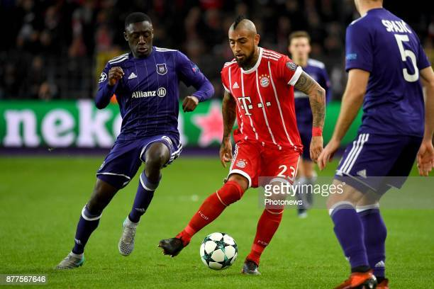 Dennis Appiah defender of RSC Anderlecht Arturo Vidal midfielder of Bayern during the UEFA Champions League group B match between RSC Anderlecht and...