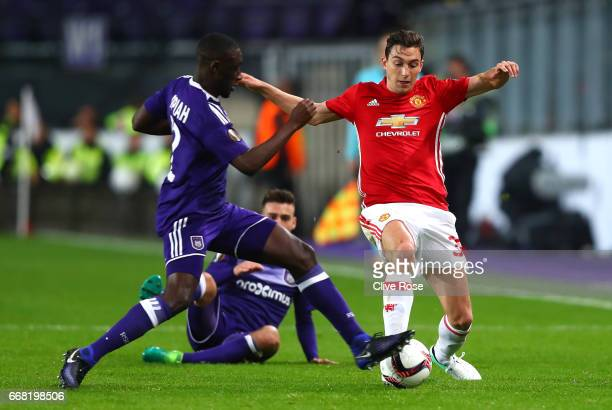 Dennis Appiah of RSC Anderlecht tackles Matteo Darmian of Manchester United during the UEFA Europa League quarter final first leg match between RSC...