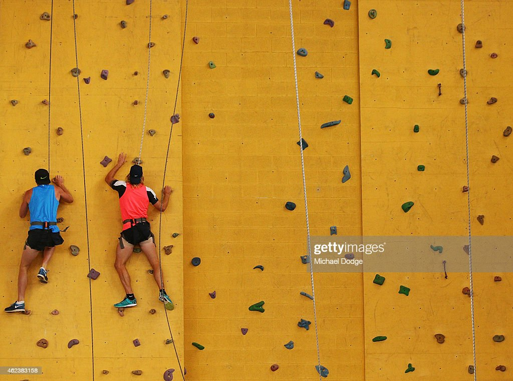 Dennis Armfield (R) climbs up a rock wall in the recreation centre on Mount Buller during the Carlton Blues AFL training camp on January 28, 2015 in Mount Buller, Australia.