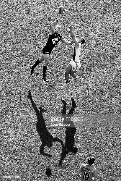 Dennis Armfield of the Blues and Luke Dunstan of the Saints compete for the ball during the round 20 AFL match between the Carlton Blues and the St...