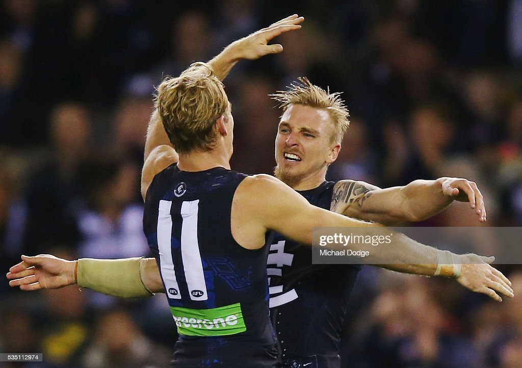 Dennis Armfield of the Blues celebrates a goal with Sam Kerridge (L) during the round 10 AFL match between the Carlton Blues and the Geelong Cats at Etihad Stadium on May 29, 2016 in Melbourne, Australia.