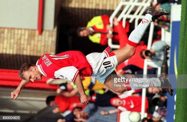 Dennis Bergkamp celebrates after scoring the winning goal for Arsenal in their FA Carling Premiership match against Sheffield Wednesday at Highbury...