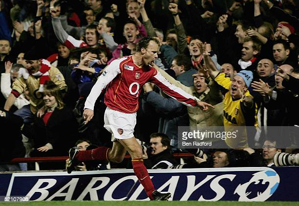 Dennis Bergkamp of Arsenal celebrates by pointing at the photographers after scoring their second goal of the game during the Barclays Premiership...