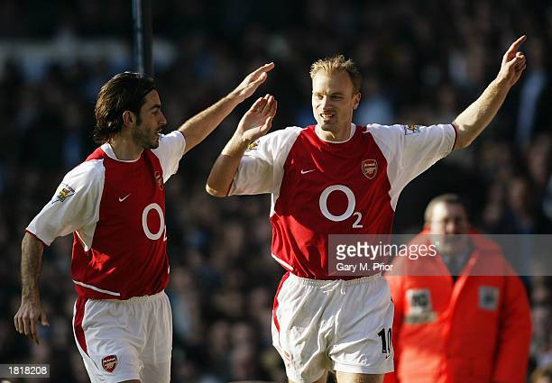 Dennis Bergkamp of Arsenal celebrates scoring the opening goal with teammate Robert Pires during the FA Barclaycard Premiership match between...