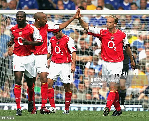 Dennis Bergkamp of Arsenal celebrates with Thierry Henry after scoring the first goal during the Barclays Premiership match between Everton and...