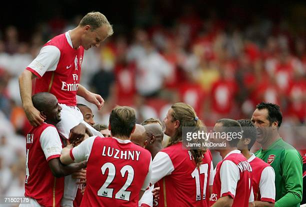 Dennis Bergkamp of Arsenal is carried aloft by teammates following his final game during the Dennis Bergkamp testimonial match between Arsenal and...