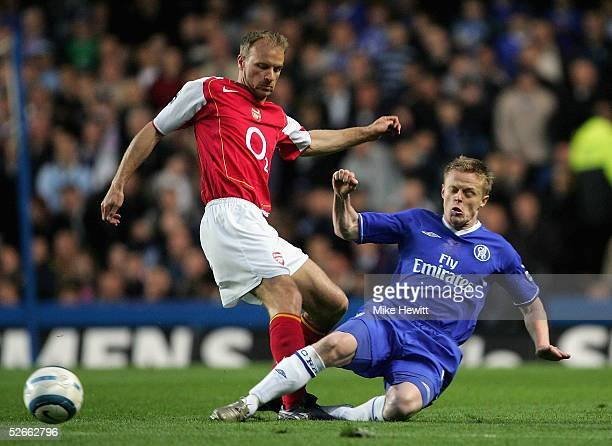 Dennis Bergkamp of Arsenal is tackled by Damien Duff of Chelsea during the Barclays Premiership match between Chelsea and Arsenal at Stamford Bridge...