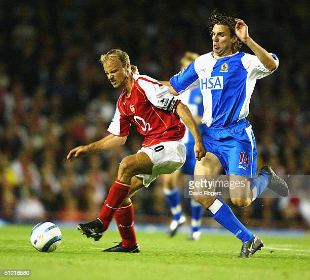 Dennis Bergkamp of Arsenal is tackled by NilsEric Johansson during the Barclays Premiership match between Arsenal and Blackburn Rovers at Highbury on...