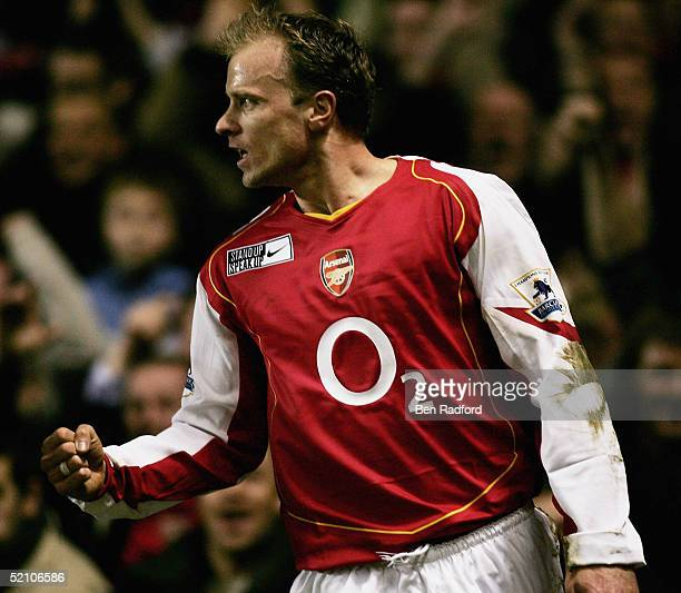 Dennis Bergkamp of Arsenal punches the air in delight after scoring the teams second goal of the game during the Barclays Premiership match between...