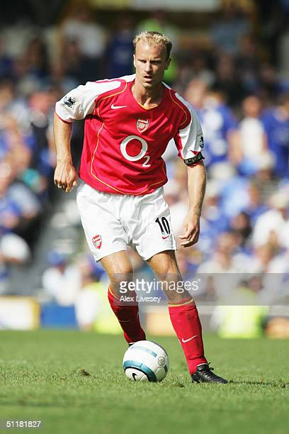 Dennis Bergkamp of Arsenal runs with the ball during the Barclays Premiership match between Everton and Arsenal at Goodison Park on August 15 2004 in...