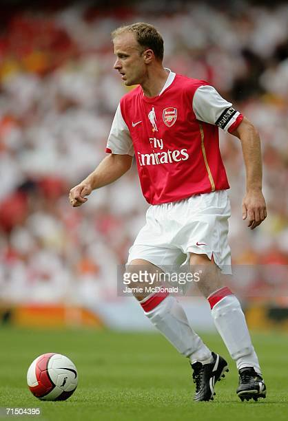 Dennis Bergkamp of Arsenal runs with the ball during the Dennis Bergkamp testimonial match between Arsenal and Ajax at the Emirates Stadium on July...