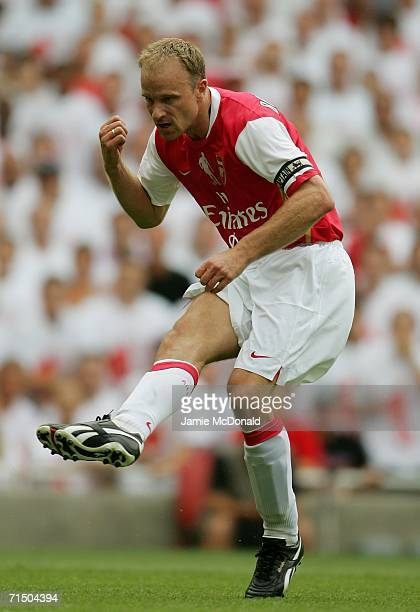 Dennis Bergkamp of Arsenal shoots on goal during the Dennis Bergkamp testimonial match between Arsenal and Ajax at the Emirates Stadium on July 22...