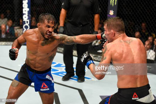 Dennis Bermudez punches Darren Elkins in their featherweight bout during the UFC Fight Night event inside the Nassau Veterans Memorial Coliseum on...