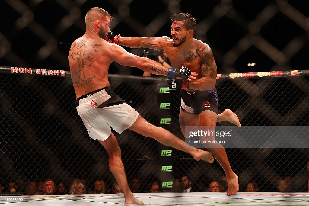 Dennis Bermudez (R) punches Jeremy Stephens in their featherweight fight during the UFC 189 event inside MGM Grand Garden Arena on July 11, 2015 in Las Vegas, Nevada.