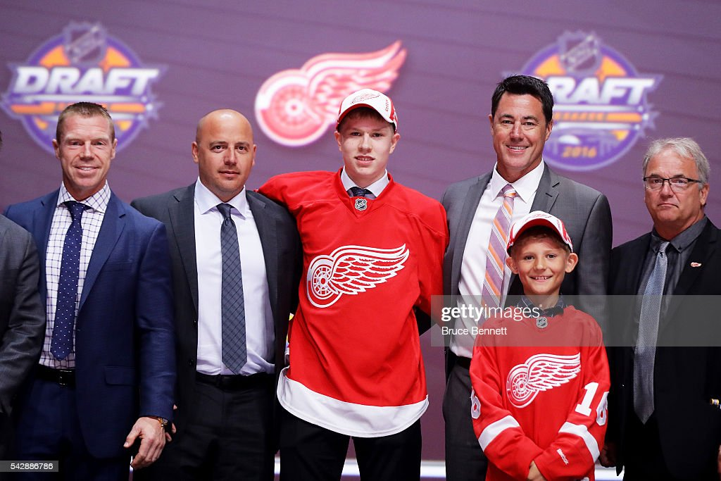 Dennis Cholowski celebrates with the Detroit Red Wings after being selected 20th overall during round one of the 2016 NHL Draft on June 24, 2016 in Buffalo, New York.