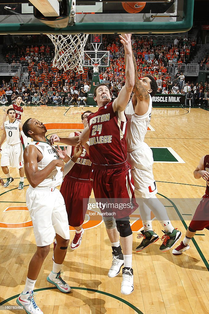 Dennis Clifford #24 of the Boston College Eagles has his shot blocked by Julian Gamble #45 of the Miami Hurricanes on February 5, 2013 at the BankUnited Center in Coral Gables, Florida. The Hurricanes defeated the Eagles 72-50.