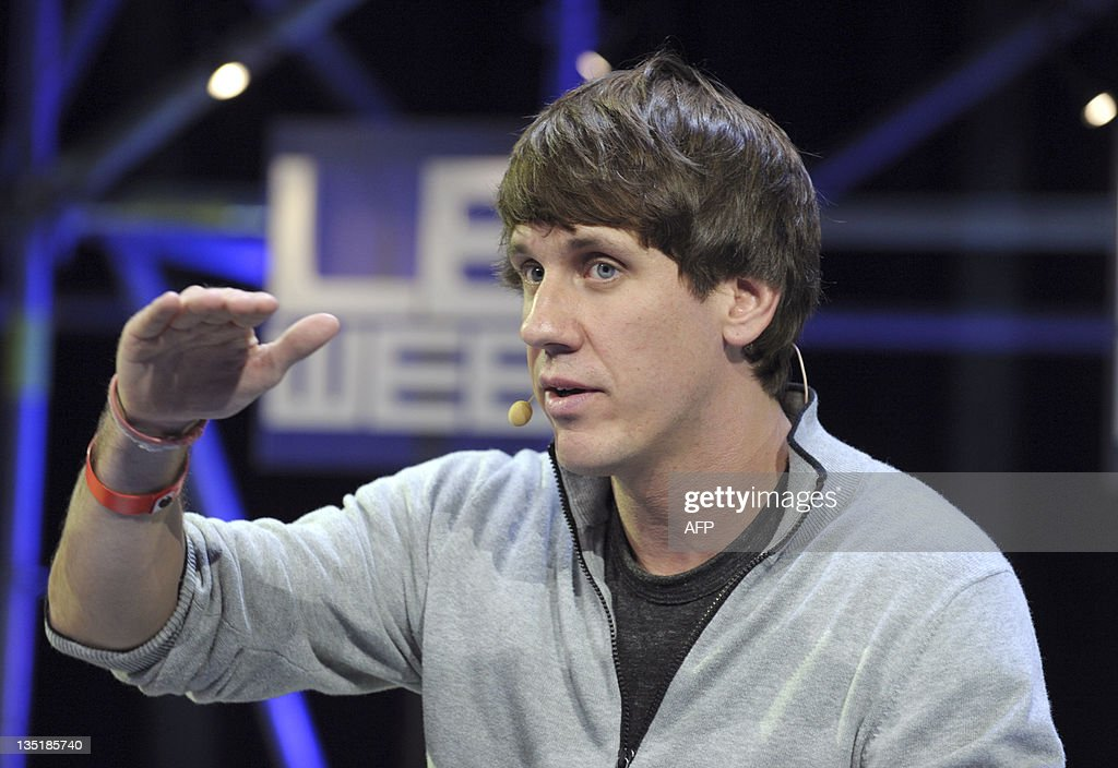 US Dennis Crowley, co-founder and CEO of social network Foursquare, gestures during a plenary session of LeWeb 11 event in Saint-Denis, suburbs of Paris, on December 7, 2011. Around 3,000 participants from 60 countries around the world are expected at LeWeb. Top industry entrepreneurs, executives, investors, senior press & bloggers gather to explore the key issues and opportunities in the web marketplace. AFP PHOTO / ERIC PIERMONT