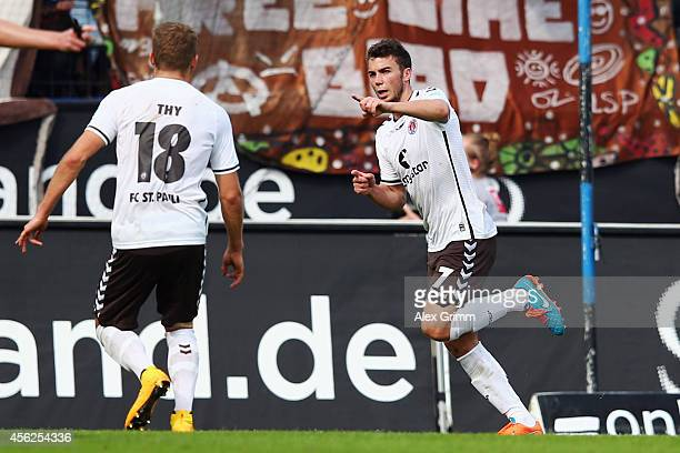 Dennis Daube 8r9 of St Pauli celebrates his team's third goal with team mate Lennart Thy during the Second Bundesliga match between FSV Frankfurt and...