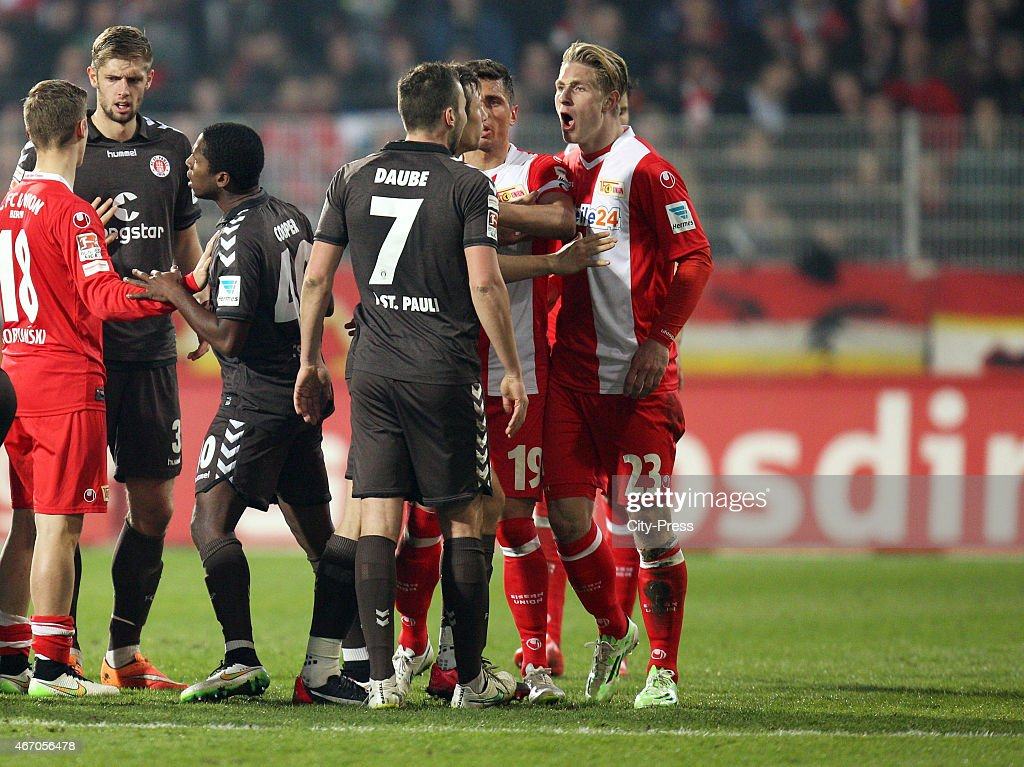 Dennis Daube of FC StPauli and Sebastian Polter of 1 FC Union Berlin argue during the match between Union Berlin and FC St Pauli on March 20 2015 in...
