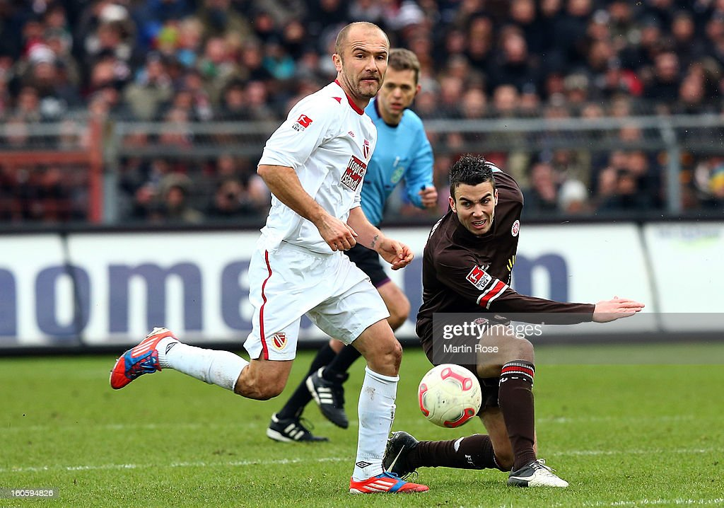 Dennis Daube (R) of St. Pauli and Ivica Banovic (L) of Cottbus battle for the ball during the second Bundesliga match between FC St. Pauli and Energie Cottbus at Millerntor Stadium at Millerntor Stadium on February 3, 2013 in Hamburg, Germany.
