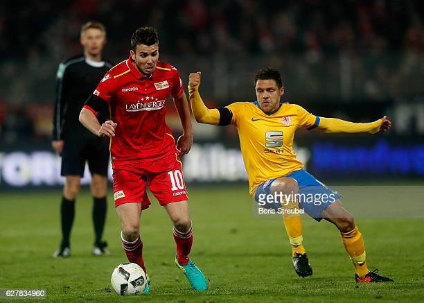 Dennis Daube of Union Berlin is challenged by Mirko Boland of Eintracht Brauschweig during the Second Bundesliga match between 1 FC Union Berlin and...