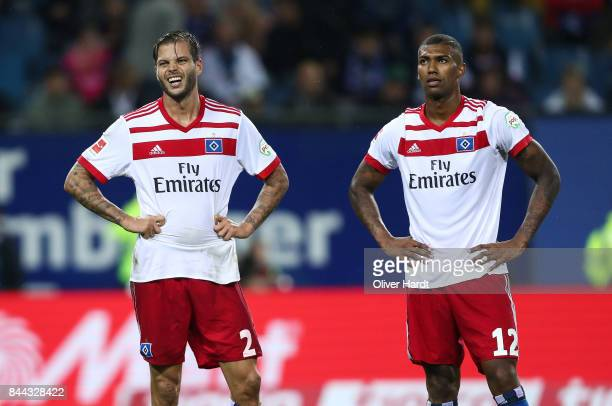 Dennis Diekmeier and Walace of Hamburg appears frustrated during the Bundesliga match between Hamburger SV and RB Leipzig at Volksparkstadion on...