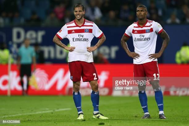 Dennis Diekmeier and Walace of Hamburg react during the Bundesliga match between Hamburger SV and RB Leipzig at Volksparkstadion on September 8 2017...