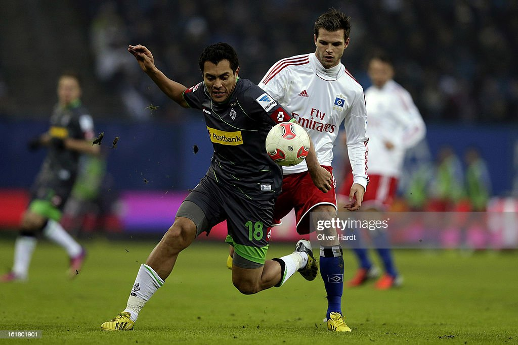 Dennis Diekmeier (R) of Hamburg and Juan Arango (L) of Gladbach battle for the ball during the Bundesliga match between Hamburger SV and Borussia Moenchengladbach at Imtech Arena on February 16, 2013 in Hamburg, Germany.