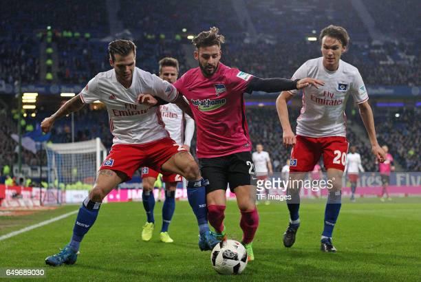 Dennis Diekmeier of Hamburg and Marvin Plattenhardt of Hertha BSC Berlin and Albin Ekdal of Hamburg battle for the ball during the Bundesliga match...