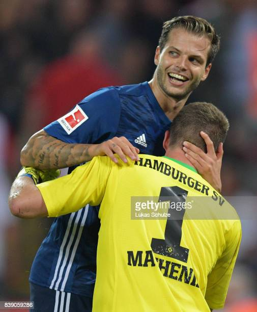Dennis Diekmeier of Hamburg celebrates with Christian Mathenia of Hamburg after the Bundesliga match between 1 FC Koeln and Hamburger SV at...