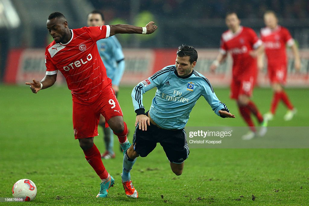 Dennis Diekmeier of Hamburg (R) challenges Nando Rafael of Duesseldorf (L) during the Bundesliga match between Fortuna Duesseldorf and Hamburger SV at Esprit-Arena on November 23, 2012 in Duesseldorf, Germany.
