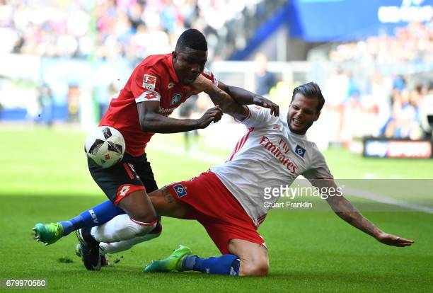 Dennis Diekmeier of Hamburg is challenged by Jhon Crdoba of Mainz during the Bundesliga match between Hamburger SV and 1 FSV Mainz 05 at...