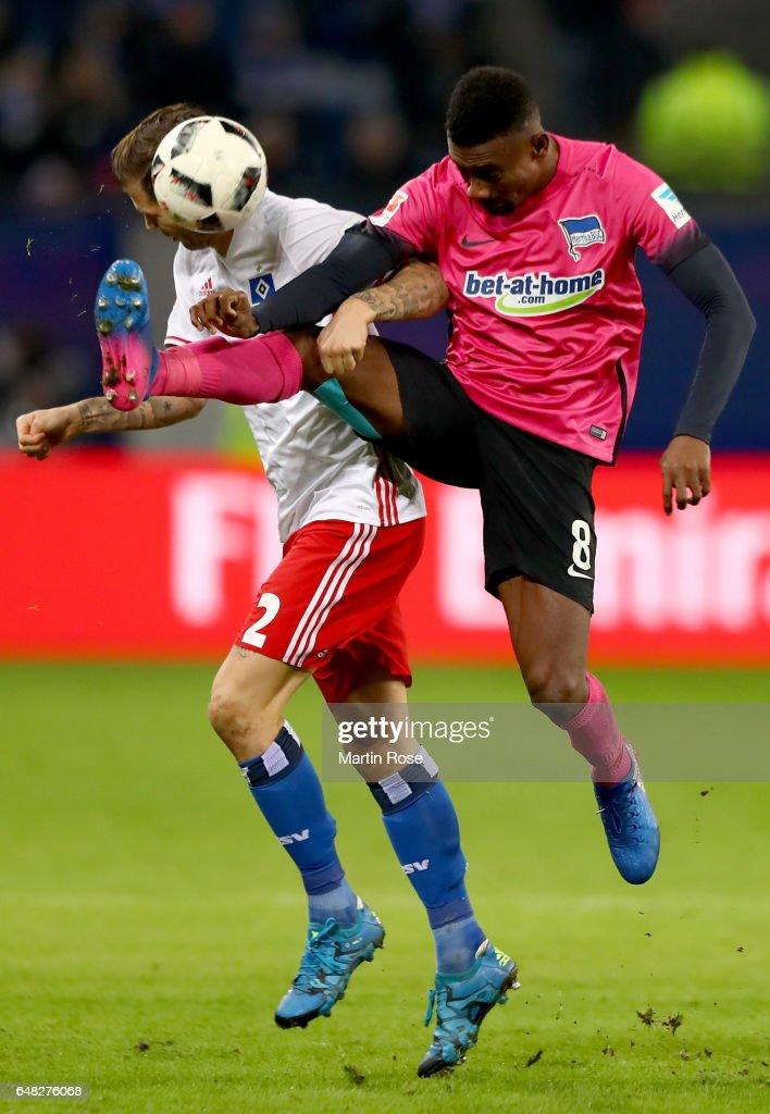 Dennis Diekmeier of Hamburg is challenged by Salomon Kalou of Berlin during the Bundesliga match between Hamburger SV and Hertha BSC at Volksparkstadion on March 5, 2017 in Hamburg, Germany.