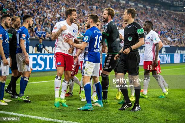 Dennis Diekmeier of Hamburg reacts after fouled by Sead Kolasinac of Schalke during the Bundesliga match between FC Schalke 04 and Hamburger SV at...