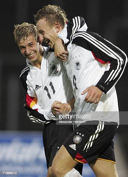 Dennis Dowidat congratulates Marvin Knoll of Germany on his 20 goal during the Men's Under 17 Four Nation Tournament between Germany and Italy at the...
