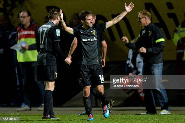Dennis Dowidat of Aachen celebrates after scoring his team's opening goal during the Regionalliga West match between Viktoria Koeln and Alemannia...