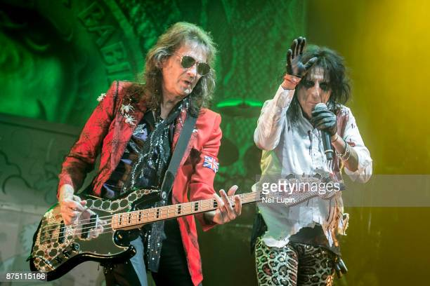 Dennis Dunaway and Alice Cooper of the Alice Cooper Band perform at Wembley Arena on November 16 2017 in London England