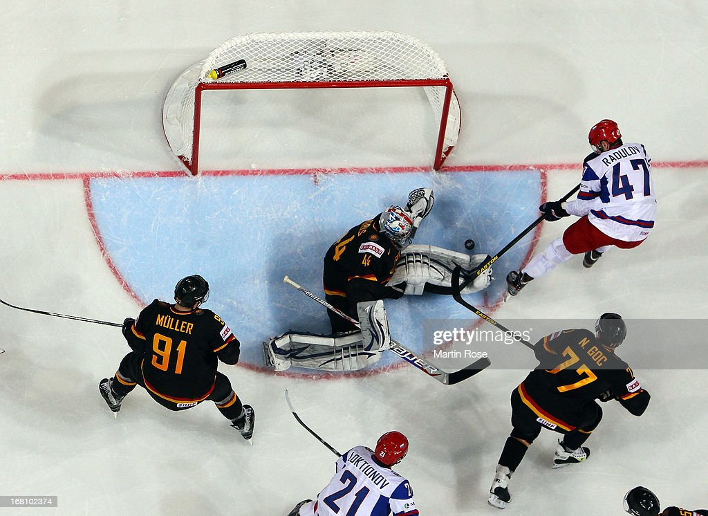 Dennis Endras (C), goaltender of Germany makes a save on Alexander Radulov (#47) of Russia during the IIHF World Championship group H match between Germany and Russia at Hartwall Areena on May 5, 2013 in Helsinki, Finland.