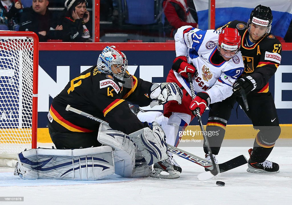 Dennis Endras (L), goaltender of Germany makes a save on Andrei Loktionov (#21) of Russia during the IIHF World Championship group H match between Germany and Russia at Hartwall Areena on May 5, 2013 in Helsinki, Finland.
