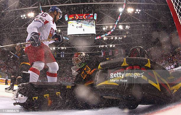 Dennis Endras goaltender of Germany makes a save on Jan Marek of Czech Republic during the IIHF World Championship qualification match between...