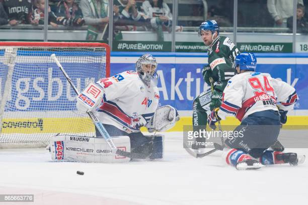 Dennis Endras of Adler Mannheim Gabe Guentzel of Augsburger Panther and Phil Hungerecker of Adler Mannheim battle for the ball during the DEL match...