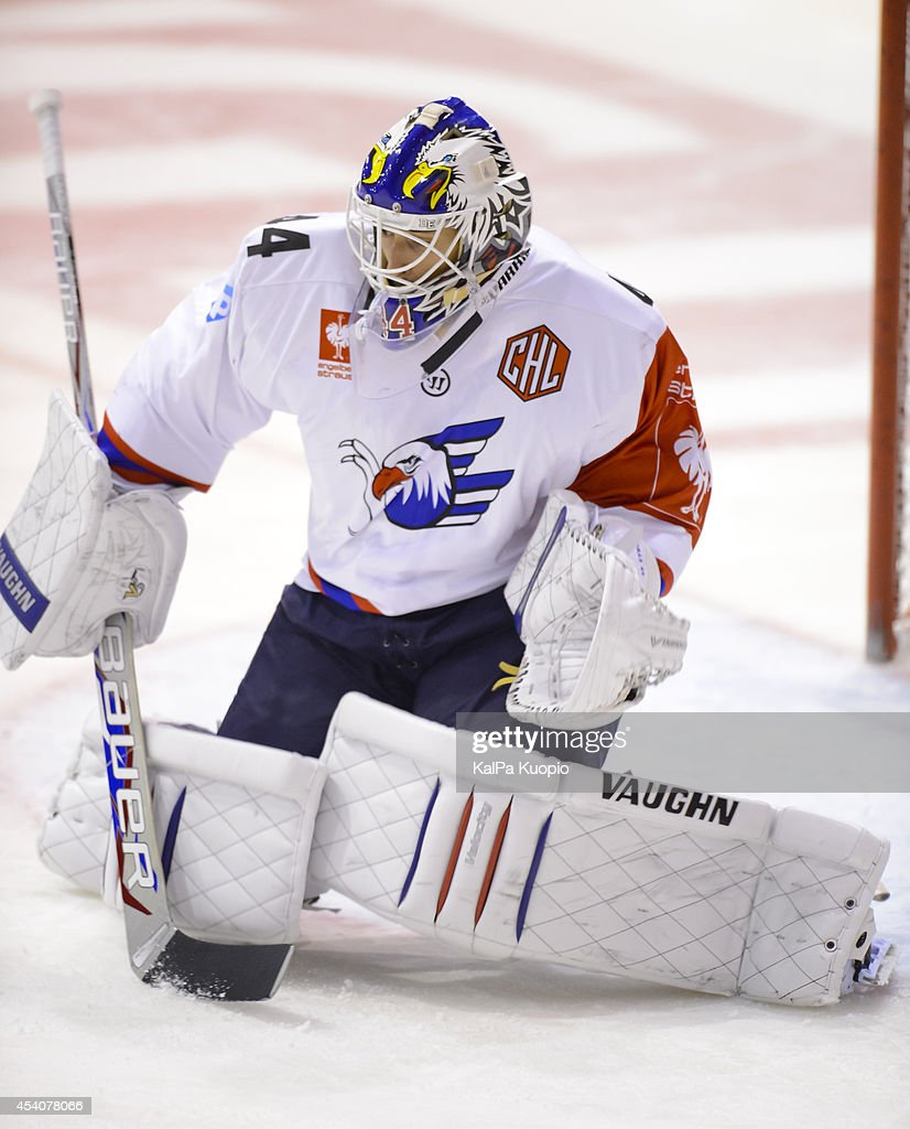 Dennis Endras #44 of Adler Mannheim saves a shot during the Champions Hockey League group stage game between KalPa Kuopio and Adler Mannheim on August 24, 2014 in in Kuopio, Finland.