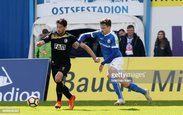 Dennis Erdmann of Rostock battles for the ball with Marius Sowislo of Magdeburg during the third league match between FC Hansa Rostock and 1FC...