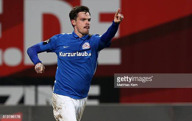 Dennis Erdmann of Rostock jubilates after scoring the first goal during the third league match between FC Hansa Rostock and Holstein Kiel at...