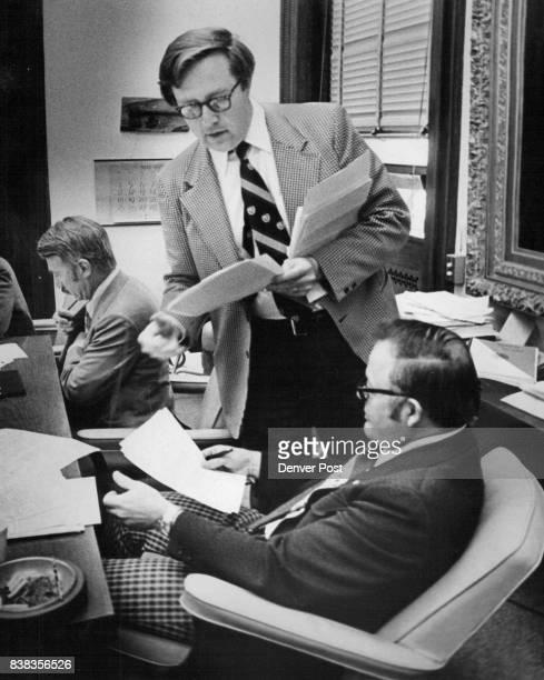 Dennis Gallagher Standing Discusses Package Of Bills Anderson RLovelond listens Sen Joe Shoemaker RDenver is at rear Credit Denver Post