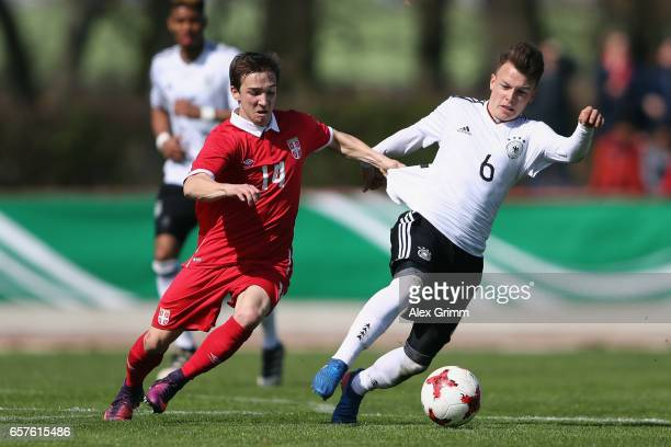 Dennis Geiger of Germany is challenged by Damjan Gojkov of Serbia during the UEFA Elite Round match between U19 Germany and U19 Serbia at Sportpark...