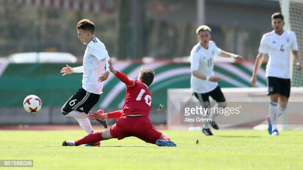 Dennis Geiger of Germany is challenged by Marko Pantic of Serbia during the UEFA Elite Round match between U19 Germany and U19 Serbia at Sportpark on...