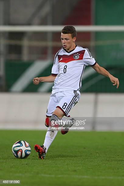 Dennis Geiger of Germany runs with the ball during the KOMM MIT tournament match between U17 Germany and U17 Netherlands at Audi Sportpark on...