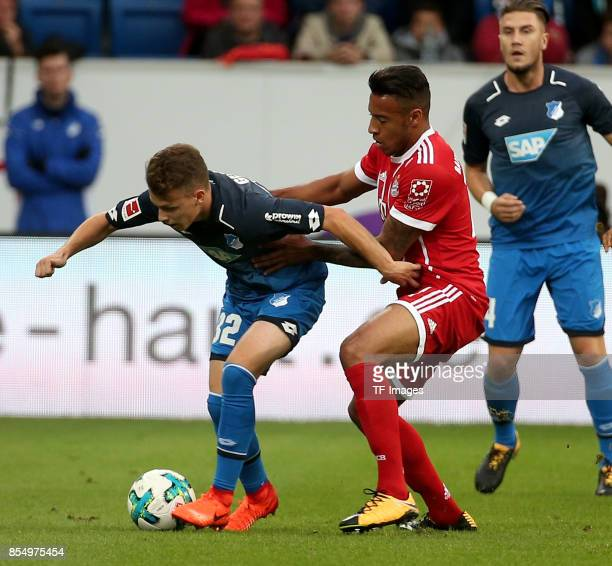 Dennis Geiger of Hoffenheim and Corentin Tolisso of Muenchen battle for the ball during the Bundesliga match between TSG 1899 Hoffenheim and FC...